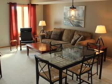 Deerwood townhome rental - Living room and dining area