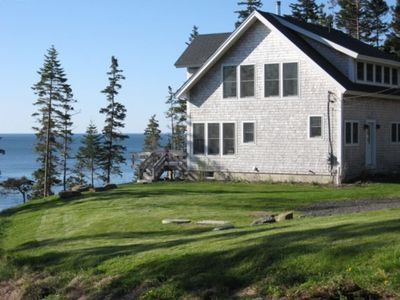 View from driveway of house, deck and ocean beyoned