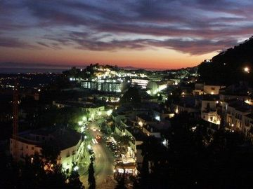 Mijas Pueblo at dusk from Casita Janine and pool.