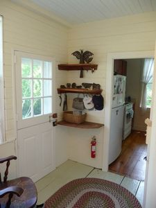 Dutch Door leading to the garden with Kitchen in background.