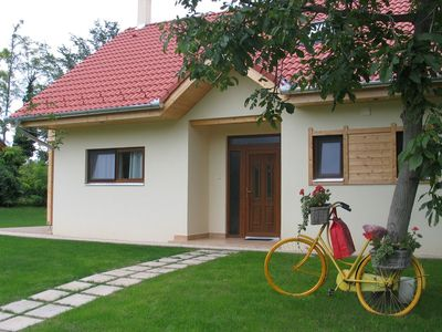 Comfortable modern villa with two bathrooms located on a small park with a view toward Lake Balaton.