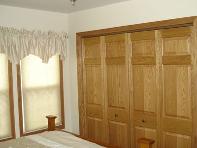 All three bedrooms have oak panel closets