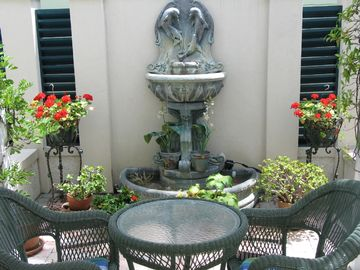 Just outside your back door; relax by the dolphin water fountain