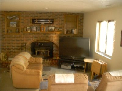 Family Room features TV, fireplace, couch, and recliners.