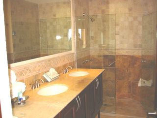 Playa del Carmen condo photo - Travertine and marble master bathroom