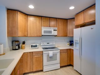 Key Largo townhome photo - Timeless cabinetry and solid surface counters