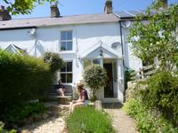 Cosy stone cottage overlooking stream and field,close to village pub