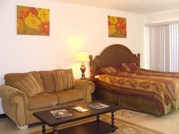 2nd bedroom with king size bed and love seat
