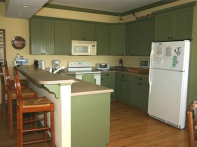Kitchen with Breakfast Bar and Dining Area Adjacent (Overlooks Porch and Creek)