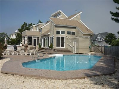 Side view, 17X35 heated pool and deck on lagoon.