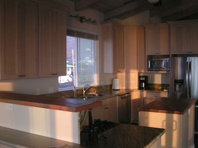 Fully equipped kitchen with custom maple cabinets and granite counters tops