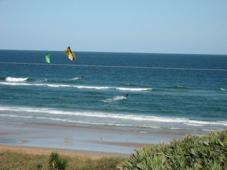 Ormond Beach condo photo - Kite boarders are fun to watch, winters lookout for whales