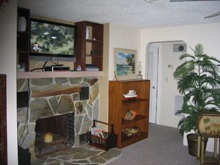 Englewood house photo - Living room fireplace w 40' TV