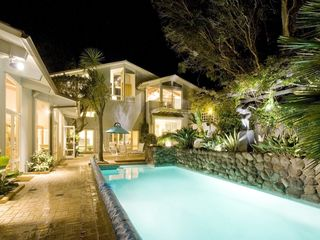 Heated swimming pool and back of house at night. - Tiburon house vacation rental photo