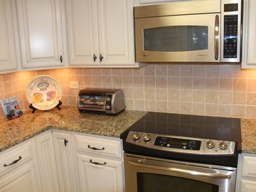 Granite counters, new cabinets, lots of storage and fully stocked with dishes.