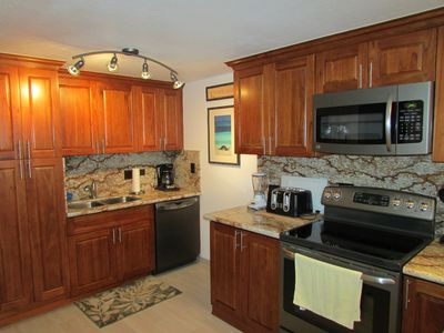 Waialua condo rental - Stove, dishwasher, and sink
