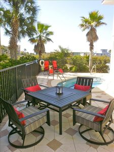 Patio features lots of seating, private pool, 2 grills, fire pit table & hammock