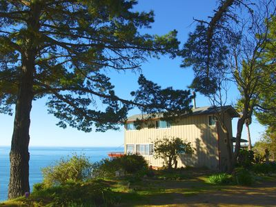 The cabin sits on a bluff overlooking HWY 1.