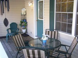 Petoskey condo photo - Enjoy breakfast out on the covered porch.