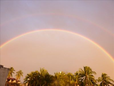 View of double rainbow from rooftop deck