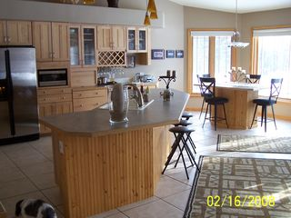 Kitchen and Entertainment Area - Pentwater house vacation rental photo
