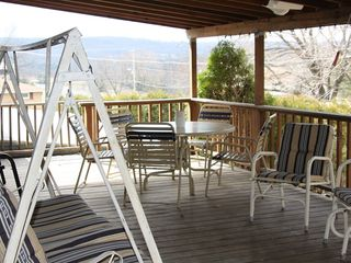 Lehighton house photo - large covered deck with plenty of seating to have a family gathering