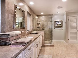 Laguna Beach house photo - Master bathroom w his and hers closets and separate toilet room