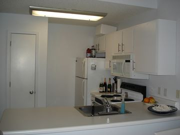 Full kitchen with Dishwasher (not pictured), stove, fridge, microwave and pantry