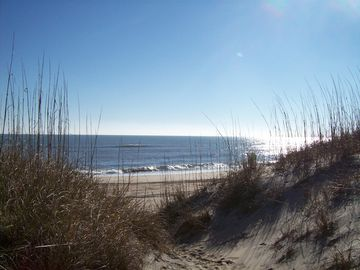 The beach at the end of the boardwalk and sandy path. No high dunes to climb!
