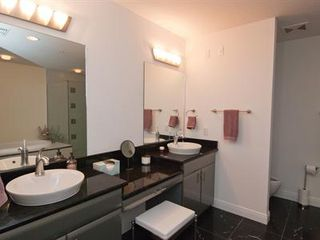 Cocoa Beach condo photo - Master bathroom double vanity with dressing table and stool!