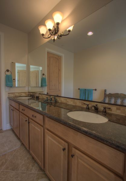 1st Master bath with double sinks and lots of cabinet space.