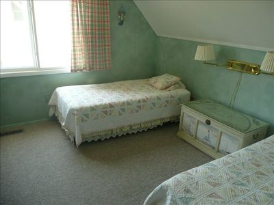 Twin beds in upstairs bedroom