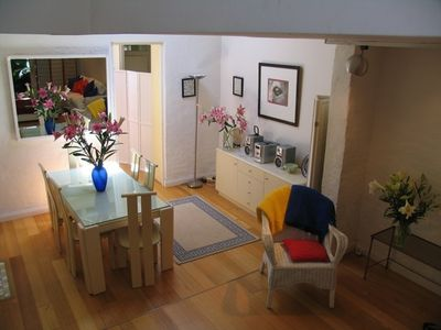 Surry Hills house rental - Dining-room with Hifi Stereo Unit with entrance to kitchen in the background.