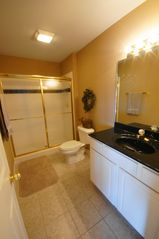 Lake Ozark condo photo - King Suite Full Bath with Large Shower & Walk-In Closet