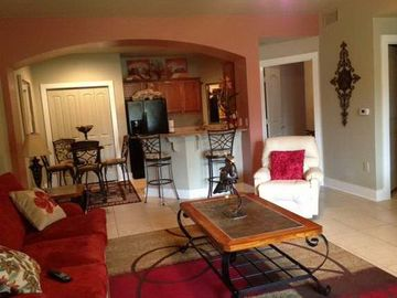 Gulf Shores condo rental - Through the living room to the kitchen. notice accent wall!