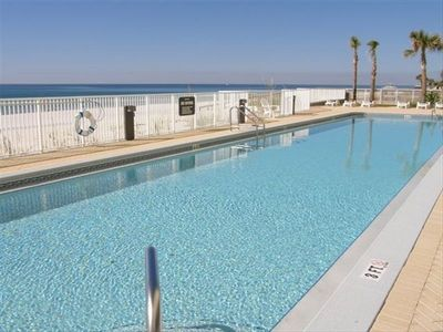 OUTDOOR POOL overlooks the Gulf