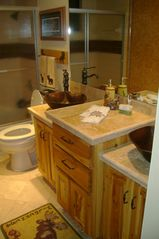 Walker cabin photo - Double sinks and shower in the guest bath. Heated floors.