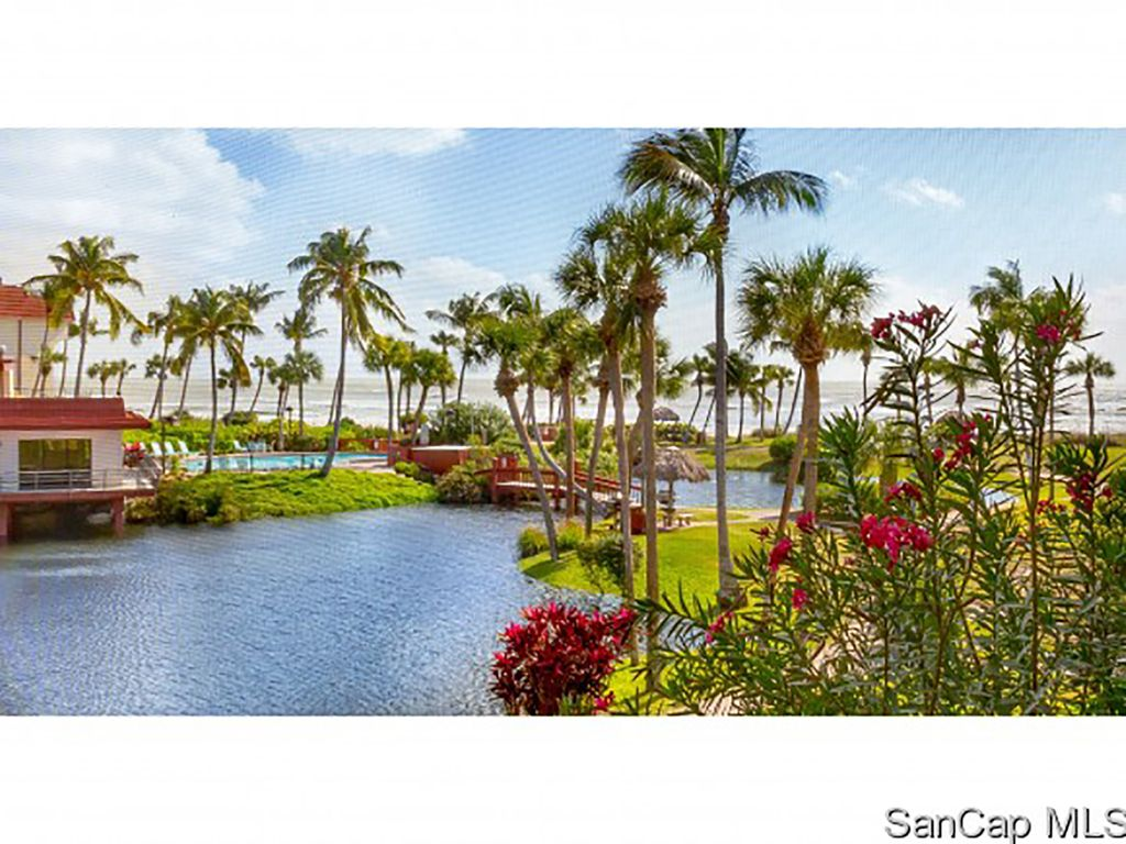 The grounds at Pointe Santo are lush with greenery, flowers, and a lagoon