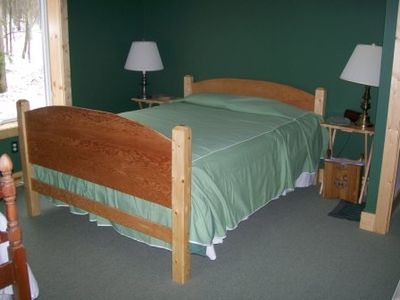 The bedroom facing the back, also has a twin bed