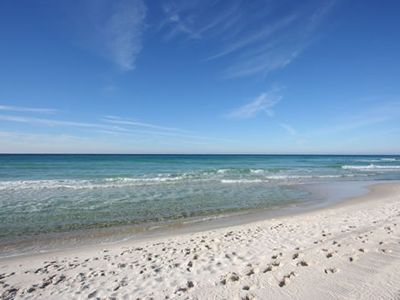 WHITE SAND BEACH AND CLEAR GULF SEA
