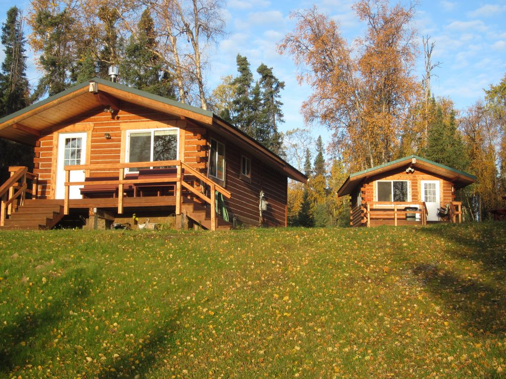 Modern log cabins on beautiful float plane lake 2 br for Vacation log homes
