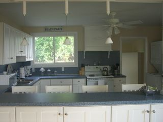 Clinton house photo - Updated Kitchen stocked with everything you will need..stackable washer/dryer