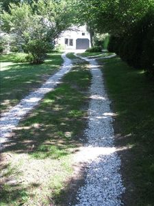 White shell driveway leading into the property