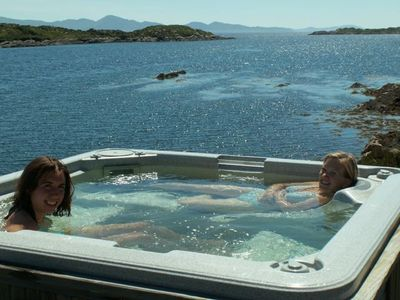After swimming, boating, fishing or snorkeling, relax in your private hot-tub.