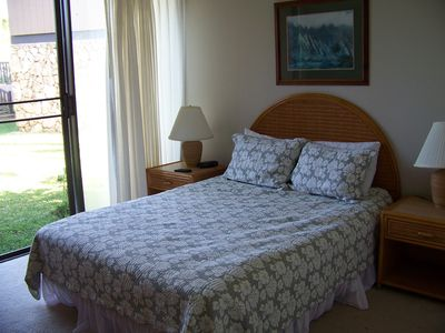 bedroom with garden view, queen bed, TV, air conditioner