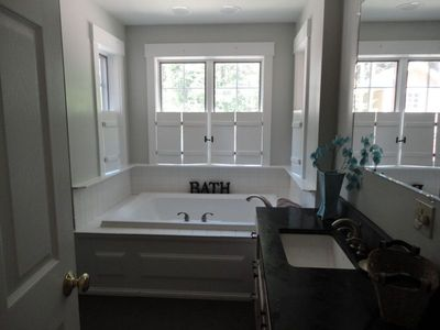 Bath in Master suite has deep tub and separate shower