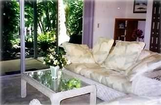 Kailua Kona condo rental - View From Living Room to North Garden Patio--Sofa & Loveseat