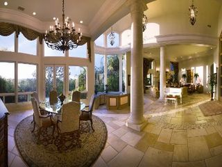 Rancho Santa Fe estate photo - Grand Foyer with Full Bar, Formal Dining and Formal Living room.