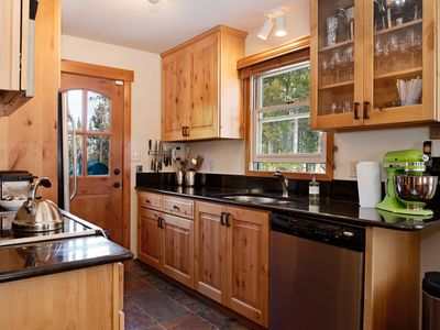 Newly equipped kitchen full of quality bench top appliances and kitchenware