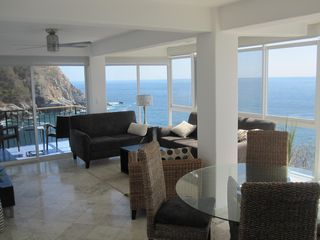 Huatulco condo photo - Livingroom and Dining Area